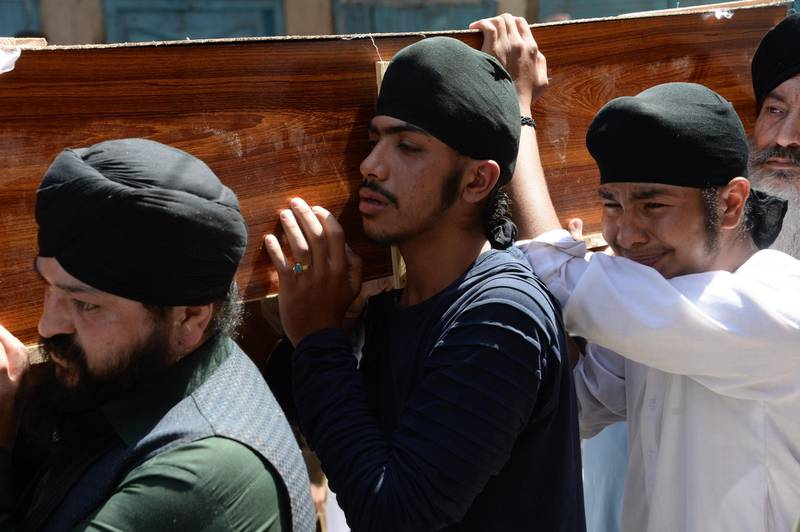 Afghan Sikhs carry the coffin of one of the 19 victims of a suicide attack in Jalalabad on July 2, 2018, a day after the attack. Grief mixed with anger among Afghanistan's minority Sikh and Hindu community on July 2 as they prepared for funerals of loved ones, including an election candidate, killed in a suicide attack.  / AFP / NOORULLAH SHIRZADA