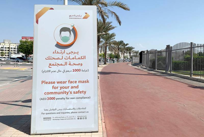 DUBAI, UNITED ARAB EMIRATES , October 10 – 2020 :- Message by Dubai Municipality about wearing face mask outside the Zabeel park in Dubai. Stickers about Covid safety measures pasted all over the park for the visitors. (Pawan Singh / The National) For News/Stock/Online.