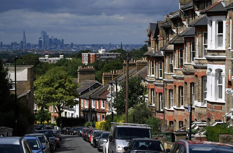Rows of terraced houses and residential properties are pictured in south London on July 6, 2020, backdropped by the skyline of the City of London. - British media reported Monday that Britain's Chancellor of the Exchequer Rishi Sunak is set to outline plans to raise the threshold at which homebuyers pay Stamp Duty on their new properties, currently set at GBP 125,000. (Photo by DANIEL LEAL-OLIVAS / AFP)