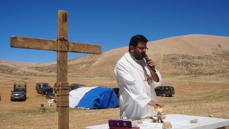 Priest Hani Tawk celebrates mass on Qornet Al Sawda, Lebanon, August 9, 2020. Photo by Aram Abdo