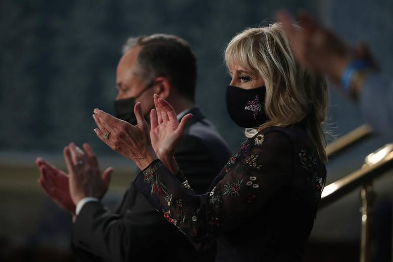U.S. First Lady Jill Biden, right, and Second Gentleman Douglas Emhoff react as U.S. President Joe Biden, not pictured, speaks during a joint session of Congress at the U.S. Capitol in Washington, D.C., U.S., on Wednesday, April 28, 2021. Bidenwill unveil a sweeping $1.8 trillion plan to expand educational opportunities and child care for families, funded in part by the largest tax increases on wealthy Americans in decades, the centerpiece of his first address to Congress. Photographer: Michael Reynolds/EPA/Bloomberg