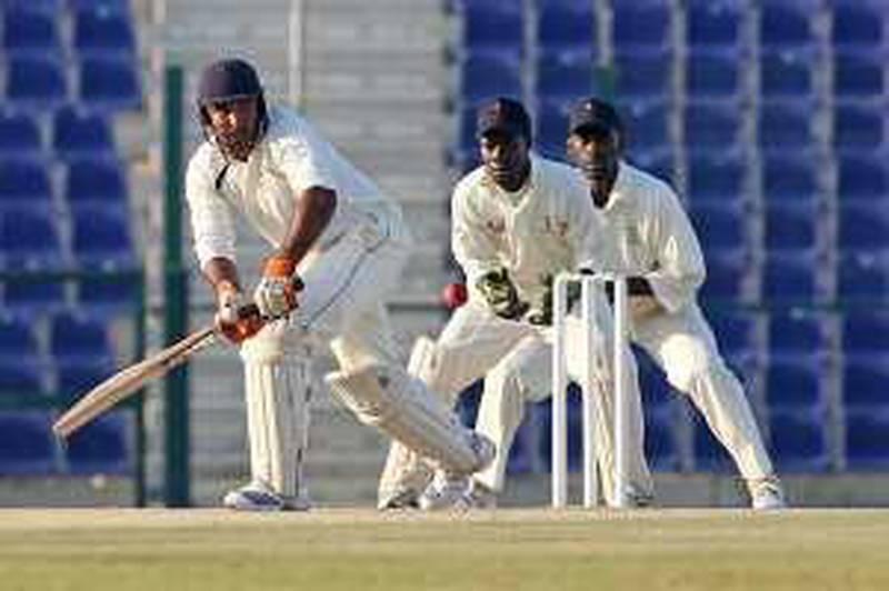 United Arab Emirates- Abu Dhabi - January 22, 2010:  SPORTS: The UAE cricket team's Arshad Ali goes to bat during their match against Uganda at Zayed Cricket Stadium in Abu Dhabi on Friday, January 22, 2010. Amy Leang/The National *** Local Caption ***  amy_012210_cricket_01.jpg