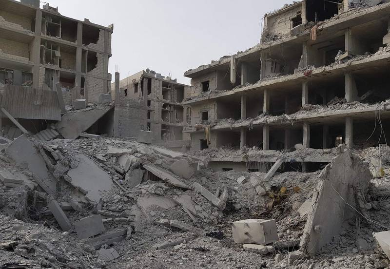 TOPSHOT - A picture taken on March 19, 2018 shows a general view of the damage in the Syrian Kurdish city of Afrin a day after Turkish-led forces entered the city.  Turkey vowed to expand its operation in northern Syria to other Kurdish-held areas after its troops and allied forces seized control of the city of Afrin in a major blow to the Kurds. / AFP PHOTO / STRINGER