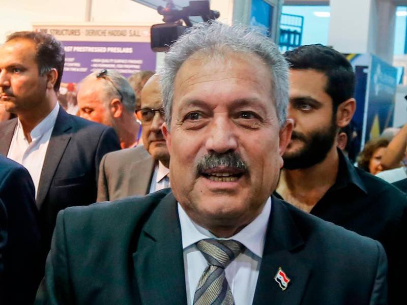 (FILES) In this file photo taken on October 2, 2018, Syria's then-Water Resources Minister Hussein Arnous attends the Trade Expo for Rebuilding Syria, in the capital Damascus. Syria President Bashar al-Assad on June 11, 2020 sacked Prime Minister Imad Khamis, replacing him by Water Resources Minister Hussein Arnous for an interim period leading to legislative polls set for next month, as the country grapples with a stinging economic crisis. / AFP / LOUAI BESHARA