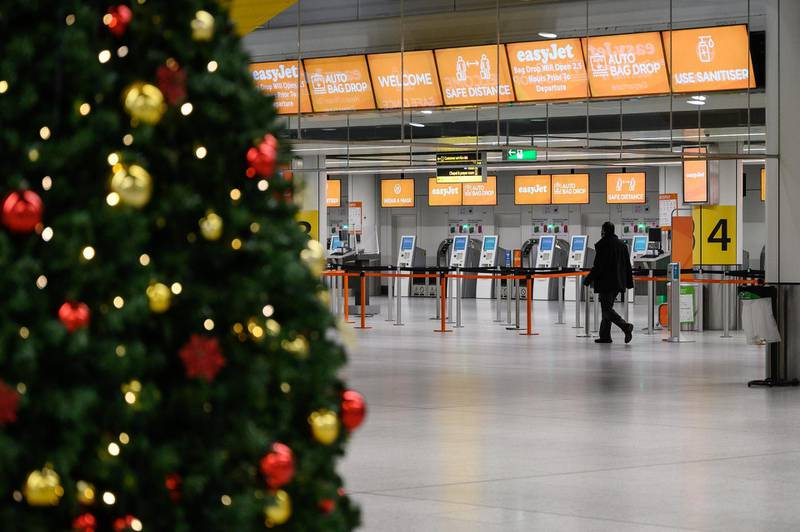 LONDON, ENGLAND - NOVEMBER 27: A person walks past the Christmas tree in the near-empty North Terminal at Gatwick Airport on November 27, 2020 in London, England. The airport will provide the PCR and swab tests, allowing passengers to travel to destinations which require them to prove they are Covid-free. Due to the COVID-19 pandemic, the number of travellers has fallen dramatically. During the period between July and September, the airport registered an 86% drop in passengers compared to the same period in 2019. The service, provided by ExpressTest, charges £60 per passenger flying from Gatwick, or £99 for general members of the public. (Photo by Leon Neal/Getty Images)