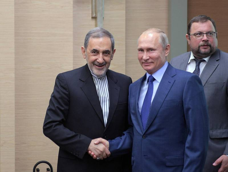 Russian President Vladimir Putin shakes hands with Ali Akbar Velayati, a top advisor to Iran's Supreme Leader Ayatollah Ali Khamenei, during their meeting at the Novo-Ogaryovo state residence outside Moscow, Russia July 12, 2018. Sputnik/Alexei Druzhinin/Kremlin via REUTERS ATTENTION EDITORS - THIS IMAGE WAS PROVIDED BY A THIRD PARTY.