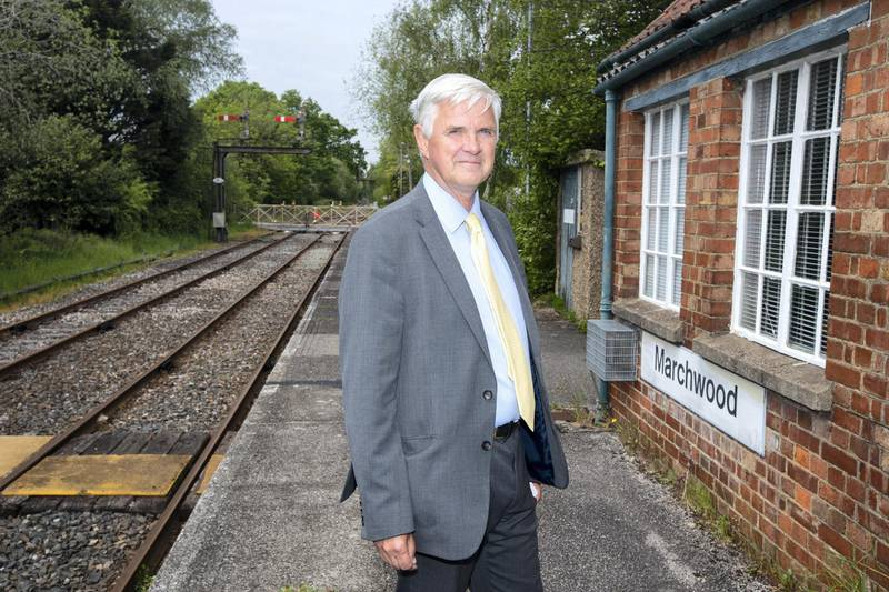 Paul Peachey feature on reinstating old railway lines, including the line the line in the New Forrest near Holmsley. Local councillor David Harrison photographed at  Marchwood station which he hopes will benifit from governement plans to open old train lines. Currently the line is used only a few times a week by the local power plant and military base.