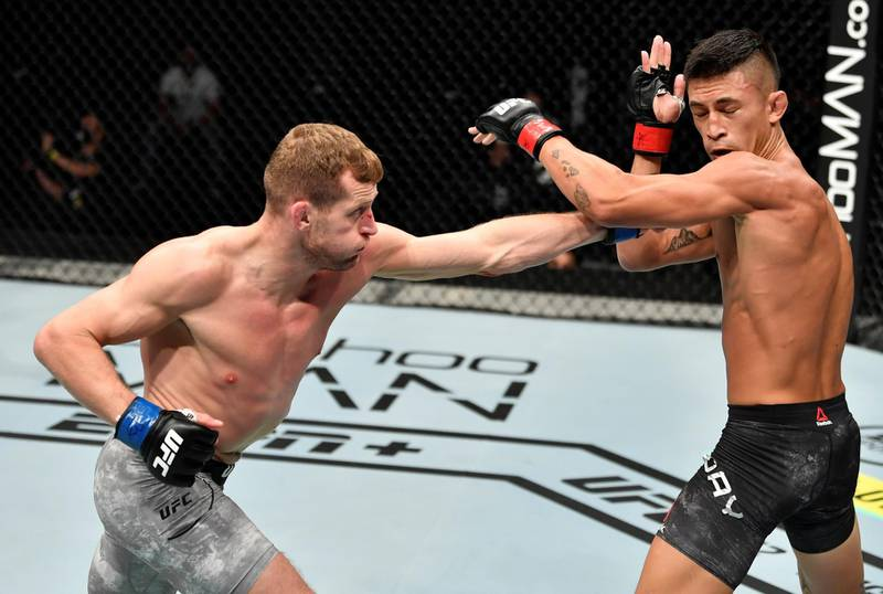 ABU DHABI, UNITED ARAB EMIRATES - JULY 12: (L-R) Davey Grant of England punches Martin Day in their bantamweight fight during the UFC 251 event at Flash Forum on UFC Fight Island on July 12, 2020 on Yas Island, Abu Dhabi, United Arab Emirates. (Photo by Jeff Bottari/Zuffa LLC)