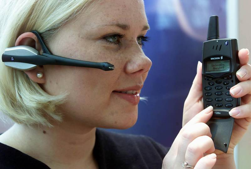 """A model uses Swedish communication giant Ericsson's wireless headset for mobile phones prior to its launch at the world's biggest computer fair """"CeBIT 2000"""" in Hanover February 23. The CeBIT opens to the public tomorrow runs until March 1."""