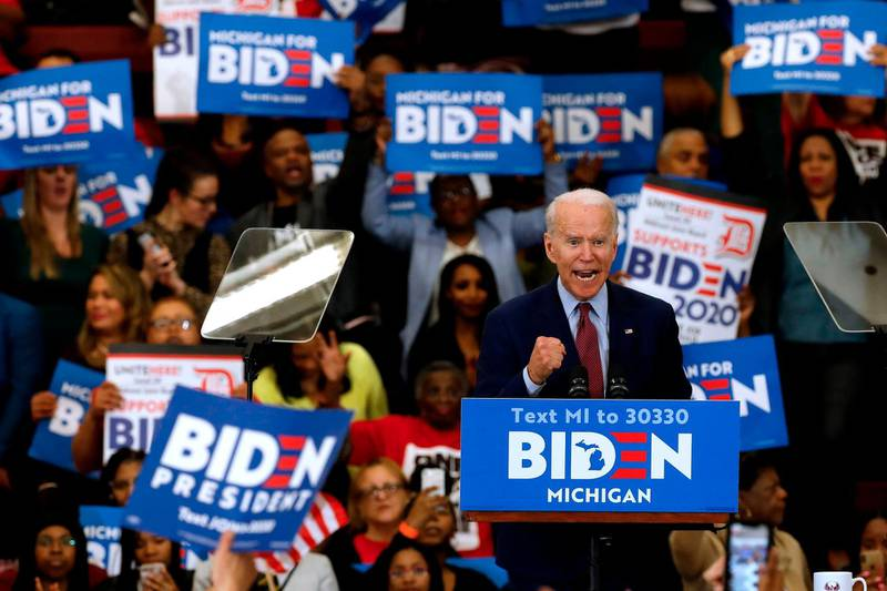 (FILES) In this file photo taken on March 09, 2020 Democratic presidential candidate former Vice President Joe Biden gestures as he speaks during a campaign rally at Renaissance High School in Detroit, Michigan. Joe Biden won the Arizona Democratic primary over Bernie Sanders, giving him a sweep of the three US states which voted on March 17, 2020, TV networks said. With 56 percent of precincts reporting in Arizona, Biden led Sanders by 42.6 percent to 30.3 percent, according to New York Times figures. Biden also won primaries in Florida and Illinois on Tuesday to open up a commanding lead over Sanders in the race for the Democratic presidential nomination.  / AFP / JEFF KOWALSKY