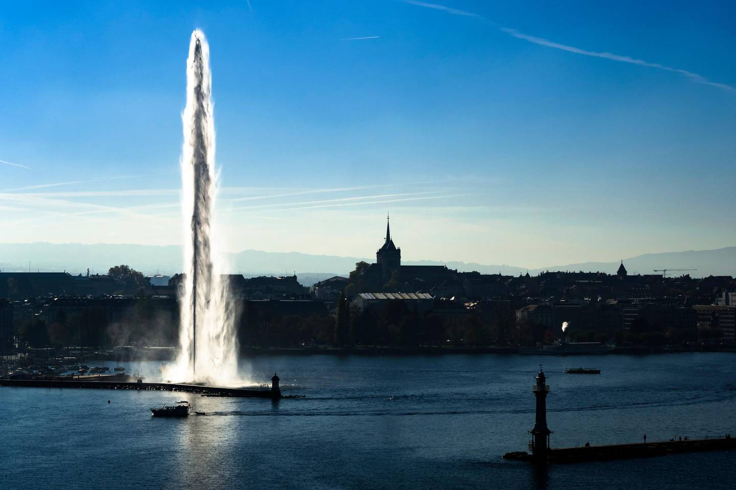 """FILE - In this Oct. 26, 2017 file photo, taken with a drone, the Geneva Water Fountain landmark, """"Jet d'Eau"""" in French, rises above the harbor and in front of the European headquarters of the United Nations in Geneva, Switzerland. President Joe Biden will hold a summit with Russian President Vladimir Putin next month in Geneva, a face-to-face meeting between the two leaders that comes amid escalating tensions between the U.S. and Russia in the first months of the Biden administration. The White House confirmed details of the summit set for June 16 on Tuesday May 25, 2021. (Valentin Flauraud/Keystone via AP, File)"""