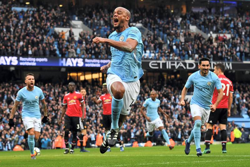 Manchester City's Belgian defender Vincent Kompany celebrates scoring the opening goal during the English Premier League football match between Manchester City and Manchester United at the Etihad Stadium in Manchester, north west England, on April 7, 2018. (Photo by Ben STANSALL / AFP) / RESTRICTED TO EDITORIAL USE. No use with unauthorized audio, video, data, fixture lists, club/league logos or 'live' services. Online in-match use limited to 75 images, no video emulation. No use in betting, games or single club/league/player publications. /