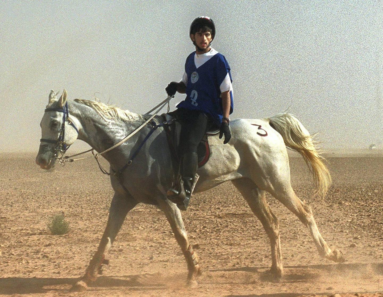 Hamdan bin Mohammed al-Maktum, son of equestrian endurance champion Dubai Crown Prince Sheikh Mohammed bin Rashid al-Maktum, rides his horse during an Equestrian Endurance Championship in Palmyra, 190 km northeast of Damascus, 01 May 2000. (Photo by LOUAI BESHARA / AFP)
