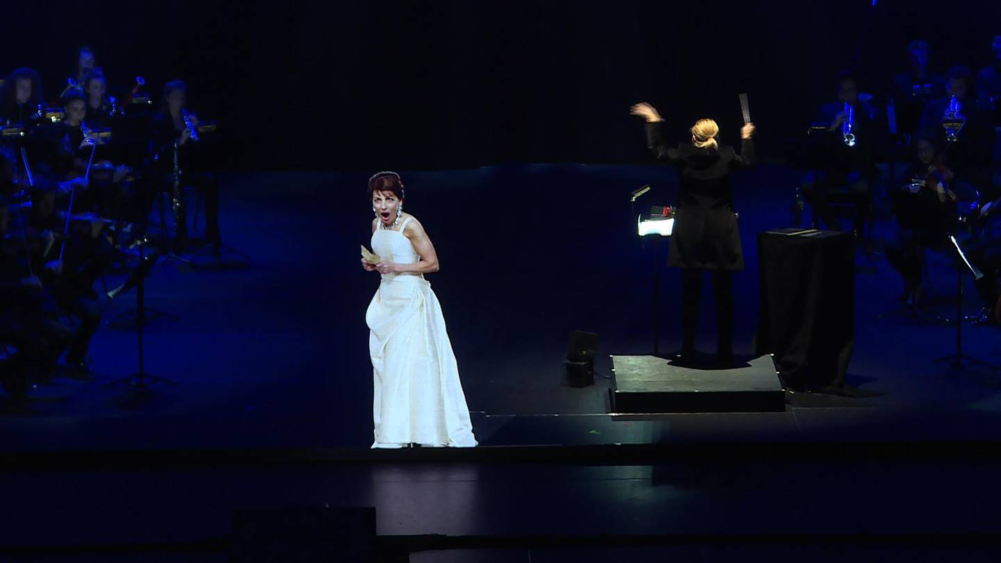 """This AFP TV video frame grab shows the hologram of Maria Callas singing on stage during an hologram-concert at the Salle Pleyel, in Paris, on November 28, 2018. - Opera diva Maria Callas """"returns"""" to the stage - as a hologram during the show 'Callas - The Hologram Show', which is shown until November 30, 2018 at the Salle Pleyel in Paris, 41 years after the singer's death. (Photo by Natalie HANDEL / AFP)"""