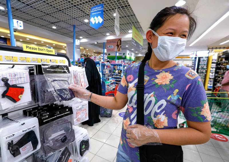Abu Dhabi, United Arab Emirates, July 30, 2020.   An Eid shopper looks at some face masks at Lulu Hypermarket, Khalidiyah Mall.Victor Besa  / The NationalSection: NAFor:  Standalone/Stock Images