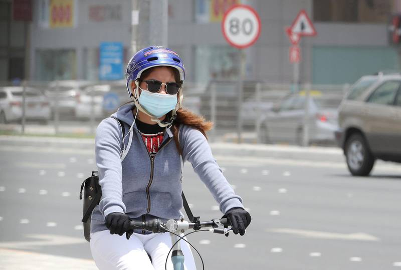 ABU DHABI, UNITED ARAB EMIRATES , June 1 – 2020 :- A woman  wearing protective face mask as a preventive measure against the spread of coronavirus on the streets of Abu Dhabi. UAE government lifts the coronavirus restriction for the residents and businesses around the country. (Pawan Singh / The National) For News/Stock