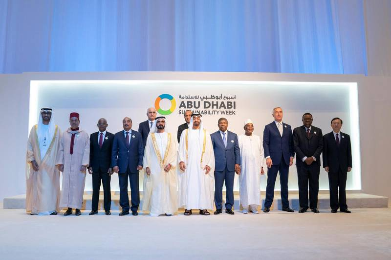 ABU DHABI, UNITED ARAB EMIRATES - January 14, 2019: HH Sheikh Mohamed bin Zayed Al Nahyan, Crown Prince of Abu Dhabi and Deputy Supreme Commander of the UAE Armed Forces (front row 6th L) and HH Sheikh Mohamed bin Rashid Al Maktoum, Vice-President, Prime Minister of the UAE, Ruler of Dubai and Minister of Defence (front row 5th L), stand for a photograph with for a group photo with Heads of State, during the opening ceremony of the World Future Energy Summit 2019, part of Abu Dhabi Sustainability Week, at Abu Dhabi National Exhibition Centre (ADNEC). Seen with (front row) HE Dr Sultan Ahmed Al Jaber, UAE Minister of State, Chairman of Masdar and CEO of ADNOC Group (L), HRH Moulay Rachid Prince of Morocco (2nd L), HE Ibrahim Mohamed Solih, President of the Maldives (3rd L), HE Mohamed Ould Abdel Aziz, President of Mauritania (4th L), HE Joao Manuel Lourenco, President of Angola (7th L), HE Ibrahim Boubacar Keita, President of Mali (8th L), HE Milo Djukanovic, President of Montenegro (9th L), HE Hage Geingob, President of Namibia (10th L), HE Yang Jiechi, Special Representative of the Chinese President (L), HE Shahin Mustafayev, Minister of Economic Development of Azerbaijan (2nd row L) and HE Taneti Mamau, President of Kiribati (2nd row R).  ( Mohamed Al Hammadi / Ministry of Presidential Affairs ) ---