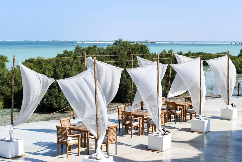 Abu Dhabi, United Arab Emirates - The breakfast terrace overlooking the mangroves at Pure Eco Retreat on Jubail Island. Khushnum Bhandari for The National
