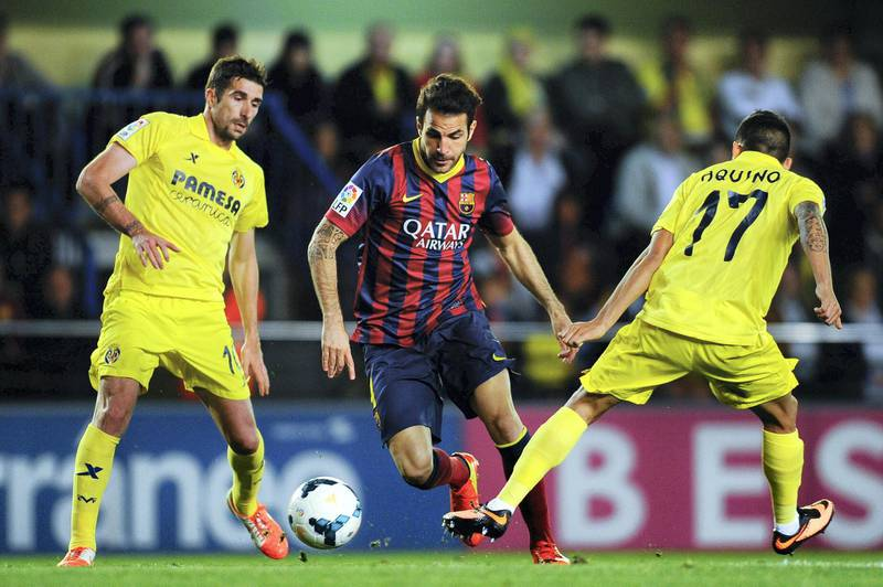VILLARREAL, SPAIN - APRIL 27:  Cesc Fabregas of FC Barcelona competes for the ball with Cani (L) and Javier Aquino of Villarreal CF during the La Liga match between Villarreal CF and FC Barcelona at El Madrigal on April 27, 2014 in Villarreal, Spain.  (Photo by David Ramos/Getty Images)