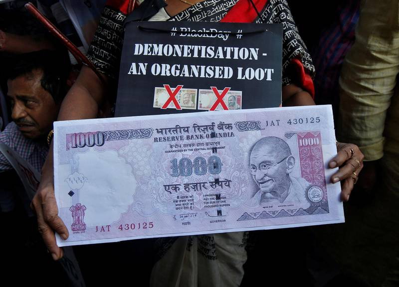 A demonstrator holds a replica of an abolished 1000 ruppee note during a protest, organised by India's main opposition Congress party, to mark a year since demonetisation was implemented by Prime Minister Narendra Modi, in Kolkata, India, November 8, 2017. REUTERS/Rupak De Chowdhuri