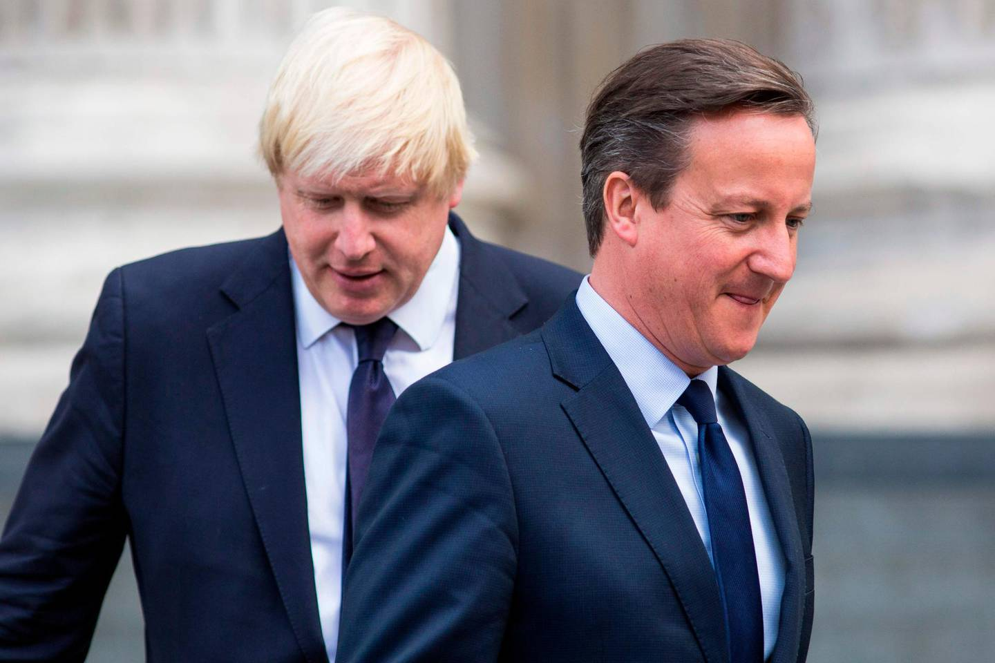 """(FILES) In this file photo taken on July 07, 2015 British Prime Minister David Cameron (R) and London Mayor Boris Johnson leave St Paul's Cathedral in central London after attending a memorial service in memory of the 52 victims of the 7/7 London attacks. Former British prime minister David Cameron said Friday he had no regrets about launching the Brexit referendum but accused current PM Boris Johnson of behaving """"appallingly"""" during the pre-vote campaigning. / AFP / JACK TAYLOR"""