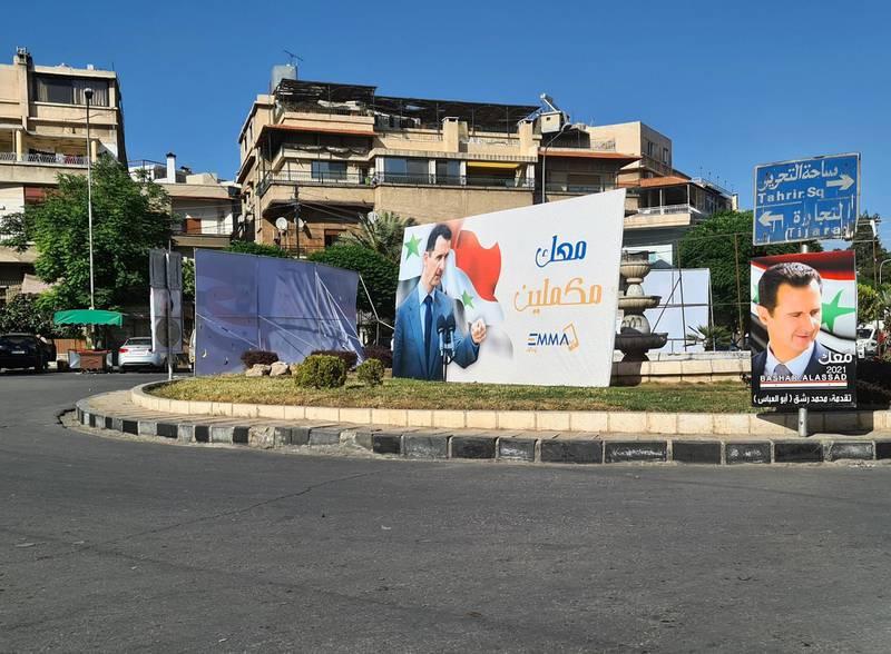Damascus, Al-Qusour roundabout telecommunications provider Emmatel post fealty message to Assad