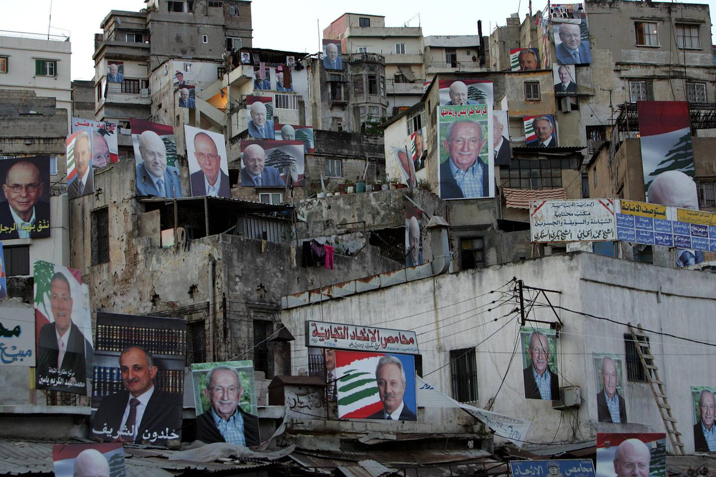 Election campaign posters cover buildings in a working class neighbourhood of the northern Lebanese port city of Tripoli, as Lebanese voters cast their ballots on June 7, 2009 in a high-stakes general election pitting a Western-backed coalition against an Iranian-backed alliance led by the Hezbollah militant group. AFP PHOTO/ANWAR AMRO / AFP PHOTO / ANWAR AMRO