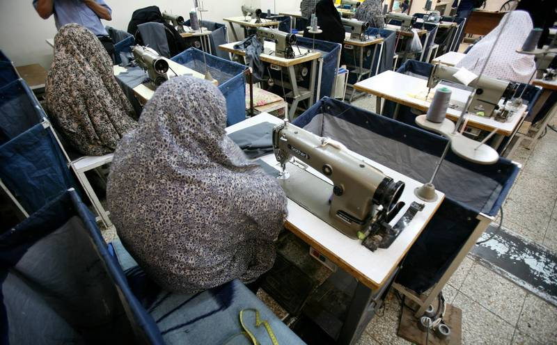 Iranian women prisoners work at a tailoring workshop in Tehran's Evin prison June 13, 2006. Iranian police detained 70 people at a demonstration in favour of women's rights, the judiciary said on Tuesday, adding it was ready to review reports that the police had beaten some demonstrators.