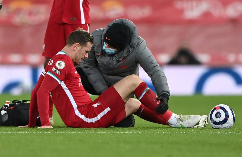 FILE PHOTO: Soccer Football - Premier League - Liverpool v Everton - Anfield, Liverpool, Britain - February 20, 2021 Liverpool's Jordan Henderson receives medical attention after sustaining an injury Pool via REUTERS/Laurence Griffiths EDITORIAL USE ONLY. No use with unauthorized audio, video, data, fixture lists, club/league logos or 'live' services. Online in-match use limited to 75 images, no video emulation. No use in betting, games or single club /league/player publications.  Please contact your account representative for further details./File Photo