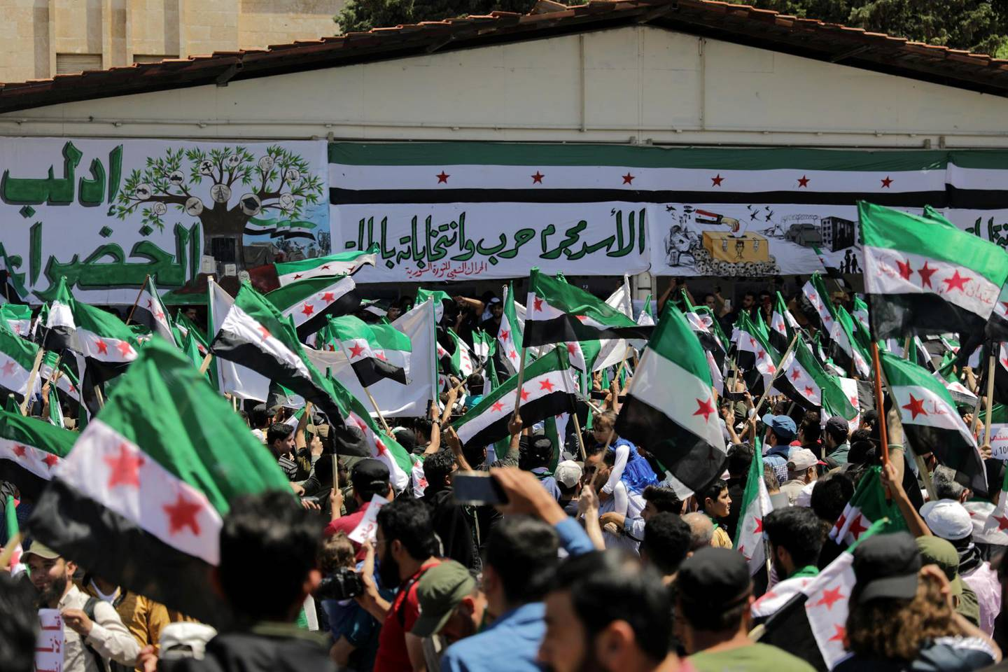 People take part in a demonstration against Syria's President Bashar al-Assad and presidential elections, in the opposition-held Idlib, Syria May 26, 2021. REUTERS/Khalil Ashawi