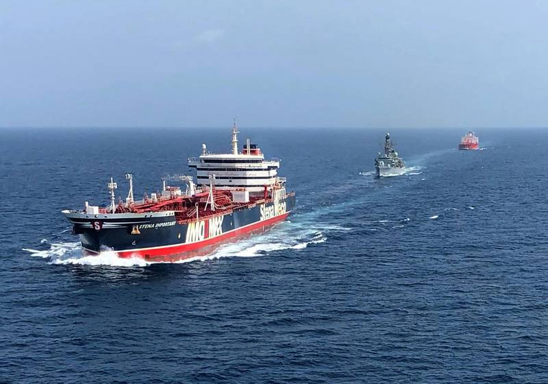 """A handout picture taken on and released by the Ministry of Defence on July 25, 2019 shows the HMS Montrose (C) accompanying the Stena Important (L) and the Sea Ploeg vessels in the Gulf.     - RESTRICTED TO EDITORIAL USE - MANDATORY CREDIT  """" AFP PHOTO / CROWN COPYRIGHT 2013 """"  -  NO MARKETING NO ADVERTISING CAMPAIGNS   -   DISTRIBUTED AS A SERVICE TO CLIENTS  -  NO ARCHIVE - TO BE USED WITHIN 2 DAYS FROM + DATE (48 HOURS), EXCEPT FOR MAGAZINES WHICH CAN PRINT THE PICTURE WHEN FIRST REPORTING ON THE EVENT  / AFP / MOD / CROWN COPYRIGHT 2019 / Handout / RESTRICTED TO EDITORIAL USE - MANDATORY CREDIT  """" AFP PHOTO / CROWN COPYRIGHT 2013 """"  -  NO MARKETING NO ADVERTISING CAMPAIGNS   -   DISTRIBUTED AS A SERVICE TO CLIENTS  -  NO ARCHIVE - TO BE USED WITHIN 2 DAYS FROM + DATE (48 HOURS), EXCEPT FOR MAGAZINES WHICH CAN PRINT THE PICTURE WHEN FIRST REPORTING ON THE EVENT"""