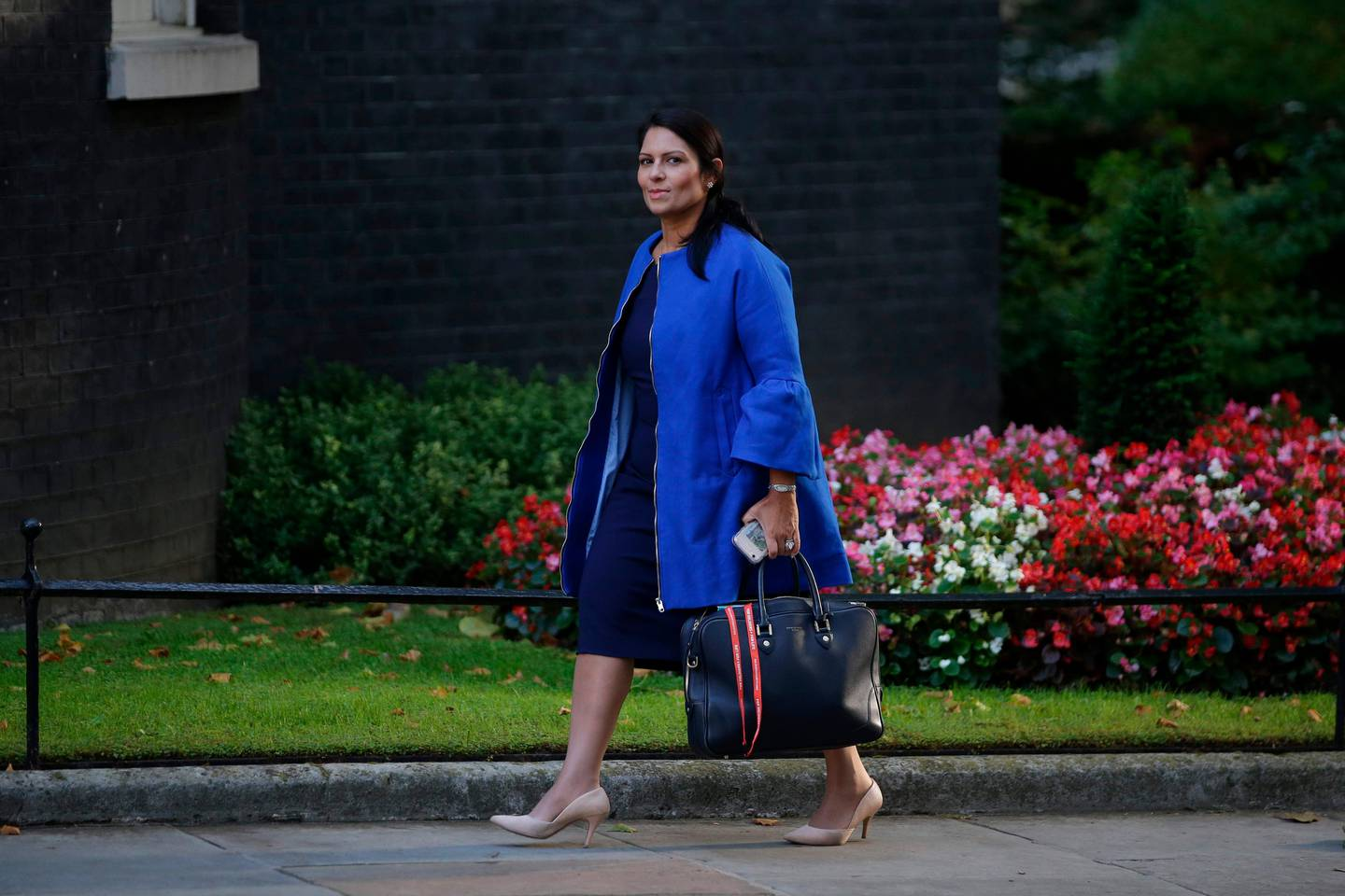(FILES) This file photo taken on September 12, 2017 shows Britain's International Development Secretary Priti Patel arriving to attend the weekly meeting of the cabinet at Downing Street in central London.  British Prime Minister Theresa May summoned her aid minister, International Development Secretary Priti Patel, back from a trip to Africa on November 8, 2017, following a row over unauthorised meetings in Israel, prompting speculation she will be the second minister in a week to be sacked. / AFP PHOTO / Daniel LEAL-OLIVAS