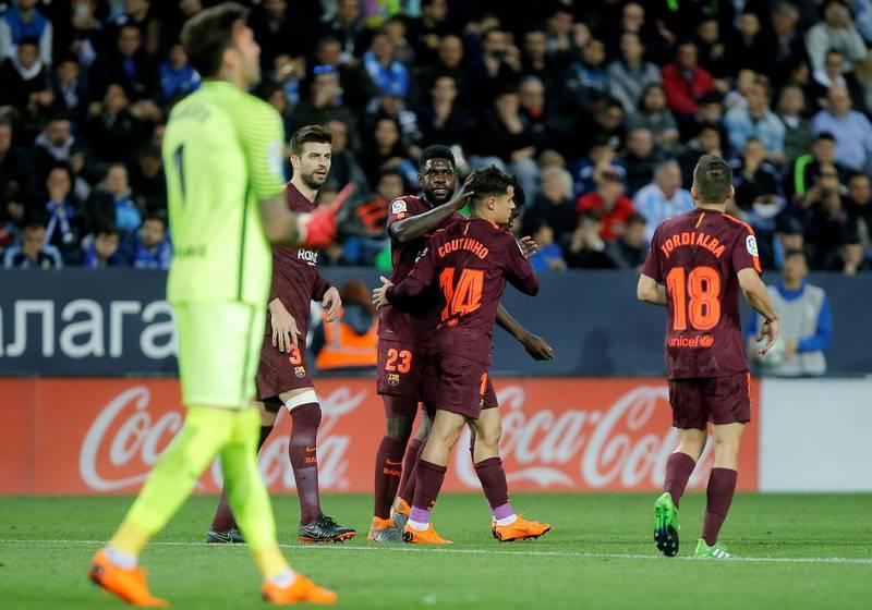 Soccer Football - La Liga Santander - Malaga CF vs FC Barcelona - La Rosaleda, Malaga, Spain - March 10, 2018   Barcelona's Philippe Coutinho celebrates scoring their second goal with Samuel Umtiti    REUTERS/Jon Nazca