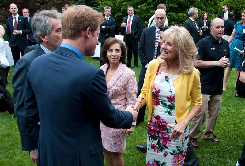 epa03209990 Britain's Prince Harry greets Dr. Jill Biden (R), the wife of U.S. Vice President Joe Biden, during a reception for U.S. and British wounded warriors at the British Ambassador's Residence in Washington, D.C., USA, on 07 May 2012. The wounded soldiers participated in the Warrior Games which is an event hosted every year by the US Olympic Committee.  EPA/KEVIN DIETSCH / POOL