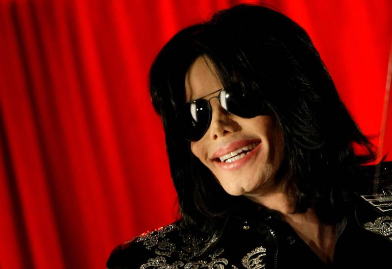 FILE PHOTO: U.S. pop star Michael Jackson gestures during a news conference at the O2 Arena in London, March 5, 2009.   REUTERS/Stefan Wermuth/File Photo