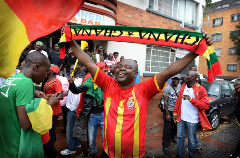 NOT FOR RESALE JOHANNESBURG - 20130120 - A Ghana supporter waves his scarve during halftime (1-0).  Yeoville is packed with Congolese and Ghanaians during the Afcon match Congo-Ghana . Photo: Bram Lammers  NOT FOR RESALE. COPYRIGHT BRAM LAMMERS PHOTOGRAPHY