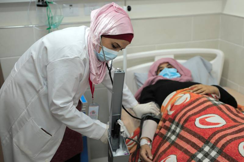 """<p><span style=""""font-size:14px"""">Heba Shalan, 40, is the mother of five children and a nurse. She lives in Jabalia refugee camp, northern Gaza Strip. Since the Covid-19 outbreak in Gaza, Heba has been living with a constant worry that she will pass the virus onto her family or the community where she lives.</span></p>  <p>&nbsp;</p>  <p><span style=""""font-size:14px"""">Gaza&rsquo;s desperately underfunded healthcare organisations are struggling to cope with the rapidly increasing demand as a result of COVID-19 and many can&rsquo;t afford to provide their staff with adequate personal protective equipment: Heba only has a basic mask and gloves to protect her while at work. Despite working long hours and putting her life on the line everyday, Heba is paid very little -just 1,100 shekels ($338) a month -and she is regularly paid late or receives less than her full salary.</span></p>  <p>&nbsp;</p>  <p><span style=""""font-size:14px"""">The work doesn&rsquo;t stop when Heba gets home&nbsp;where she is responsible for most of the housework and childcare including home-schooling her children when schools closed as a result of the pandemic. Heba says, &quot;the living conditions in Gaza are difficult because of the long-standing occupation and blockade. The pandemic made things only worse. My workload increased, which already reflected in my life and on my family.&quot;</span></p>  <p>&nbsp;</p>  <p><span style=""""font-size:14px"""">&quot;As I am a nurse, I am also a mother, I had to do most of the house and children care duties. Making food, laundry, cleaning, and teaching the children. Often, I can&#39;t keep up with all my children&#39;s lessons and assignments.&quot;</span></p>  <p>&nbsp;</p>  <p style=""""margin-left:0cm; margin-right:0cm""""><span style=""""font-size:14px"""">Heba, like all Palestinians in Israeli-occupied West Bank and Gaza, is likely to face a long wait for a COVID-19 vaccine despite Israel having rolled out a record-setting vaccination drive.&nbsp;&nbsp; As of 21 January 2021"""