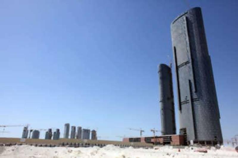 October 1, 2009 / Abu Dhabi / Sun and Sky Tower on Reem Island October 1, 2009.   ( Sammy Dallal / The National)Marina Square development at left. *** Local Caption ***  sd-100109-sunandsky-04.jpg
