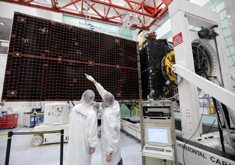 FILE PHOTO: A technician looks at a solar panel on the Inmarsat S-Band/Hellas-Sat 3 satellite in the clean room facilities of the Thales Alenia Space plant in Cannes, France, February 3, 2017.   REUTERS/Eric Gaillard/File Photo
