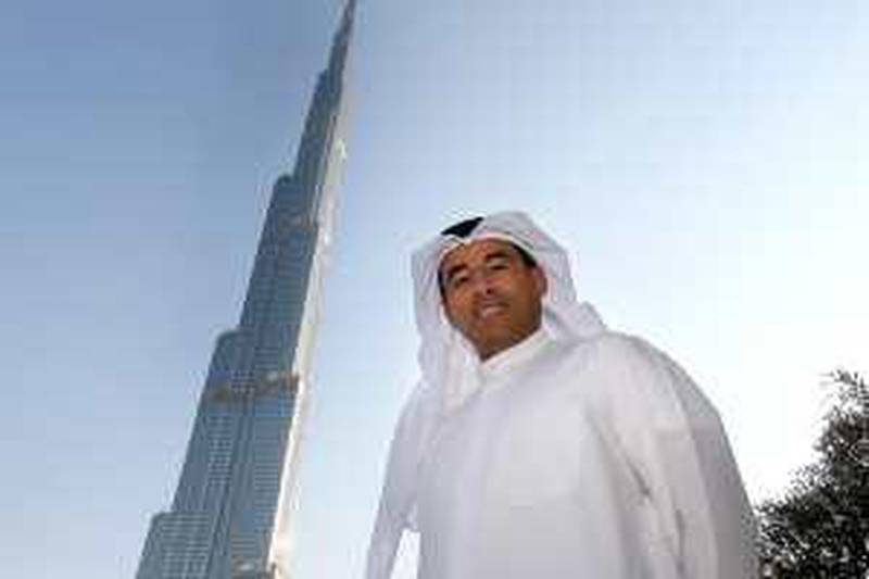 DUBAI, UNITED ARAB EMIRATES – Dec 30: Mohamed Ali Alabbar, Chairman of Emaar Properties PJSC at his office in Emaar Square in Dubai. Also seen in the photo Burj Dubai on his left. (Pawan Singh / The National) For Business. Story by Wayne Arnold *** Local Caption ***  PS3012- ALABBAR01.jpg