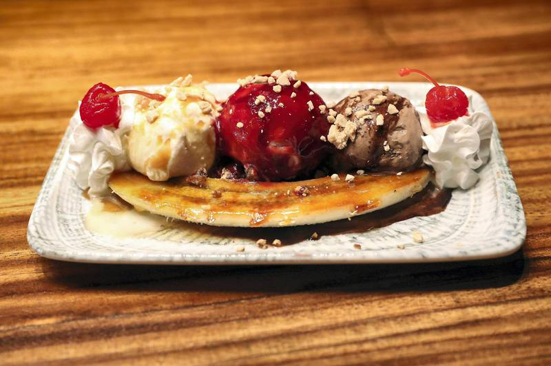 DUBAI, UNITED ARAB EMIRATES , September 27 – 2020 :-  80's Banana split dish at the Brass Monkey, new dining and entertainment destination on the Bluewaters Island in Dubai.  (Pawan Singh / The National) For Lifestyle/Online/Instagram. Story by Janice Rodrigues