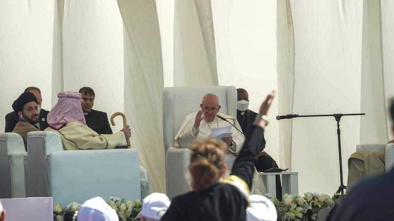 Pope Francis smiles and waves at a women that threw a kiss to him. Haider Husseini/ The National