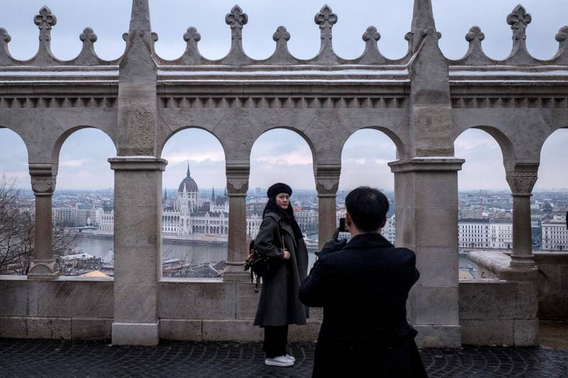 """BUDAPEST, HUNGARY - JANUARY 20: Tourists visit the Fisherman's Bastion on January 20, 2019 in Budapest, Hungary. Over the past months thousands of Hungarians have turned out in the streets to call for the resignation of Prime Minister Viktor Orban. Orban was reelected for a third term in April 2018, since taking office Orban, has rebranded his ruling party Fidesz, once a liberal youth party, as a right-wing Christian nationalist organization. After the party's victory in 2010, Orban moved to remake Hungary as what he termed """"an illiberal state."""" Since then, Orban has introduced many changes and new laws to realize this vision: the court system has been stacked with government loyalists; Orban's allies have taken control of most Hungarian media; a new labor law - dubbed the """"slave law"""" by critics - has increased the limit on overtime from 250hrs to 400hrs per year; the """"Stop Soros"""" bill targeted NGOs and individuals assisting refugees and migrants; accreditation laws for foreign universities were changed, forcing the renowned Central European University to move most operations to Vienna; and a new homeless law that criminalizes sleeping on the streets. Mr. Orban's moves have created a template for his brand of illiberal democracy, which is providing inspiration to far-right and populist leaders in Poland, Italy, France, Netherlands and Brazil.  (Photo by Chris McGrath/Getty Images)"""