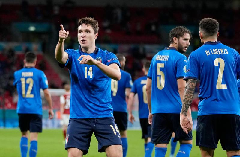 Italy's Federico Chiesa, left, celebrates with his teammates after scoring his side's opening goal during the Euro 2020 soccer championship round of 16 match between Italy and Austria at Wembley stadium in London, Saturday, June 26, 2021. (AP Photo/Frank Augstein, Pool)