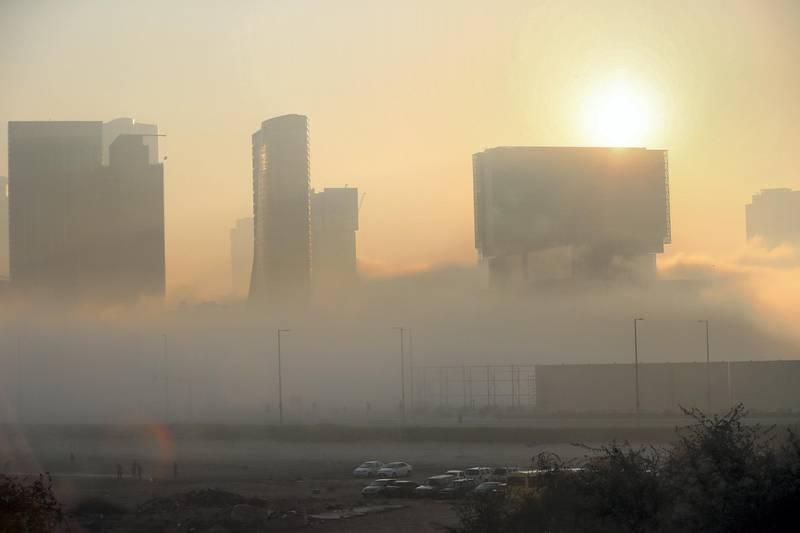 Abu Dhabi - United Arab Emirates - 22Dec2017 - Densed fog engulfed Abu Dhabi city in the morning having poor visibilty for motorist. Ravindranath K / The National