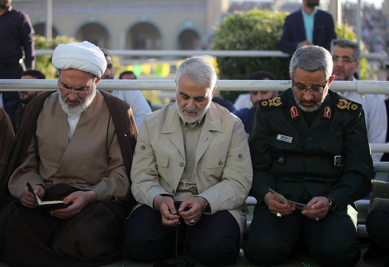 """TEHRAN, IRAN - JUNE 5: (----EDITORIAL USE ONLY  MANDATORY CREDIT - """"IRANIAN SUPREME LEADER PRESS OFFICE / HANDOUT"""" - NO MARKETING NO ADVERTISING CAMPAIGNS - DISTRIBUTED AS A SERVICE TO CLIENTS----) Major general Qasem Soleimani performS Eid al-Fitr Prayer at Grand Prayer Grounds (Mossalla) in Tehran, Iran on June 5, 2019. Muslims around the world celebrate Eid al-Fitr marking the end of the holy fasting month of Ramadan.   (Photo by IRANIAN SUPREME LEADER PRESS OFFICE - HANDOUT/Anadolu Agency/Getty Images)"""