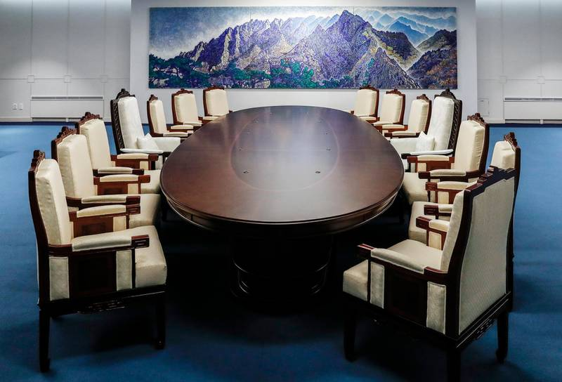 This April 23, 2018, photo provided by South Korea Presidential Blue House on Wednesday, April 25, 2018, shows a meeting room for the April 27 summit between South and North Korea at the Peace House at the southern side of the Panmunjom in the Demilitarized Zone, South Korea.  Kim Jong Un will be in unchartered territory when the third-generation autocrat crosses over to the southern half of the Demilitarized Zone separating the rival Koreas on April 27, possibly on foot, and greets South Korean President Moon Jae-in.  (South Korea Presidential Blue House via AP)