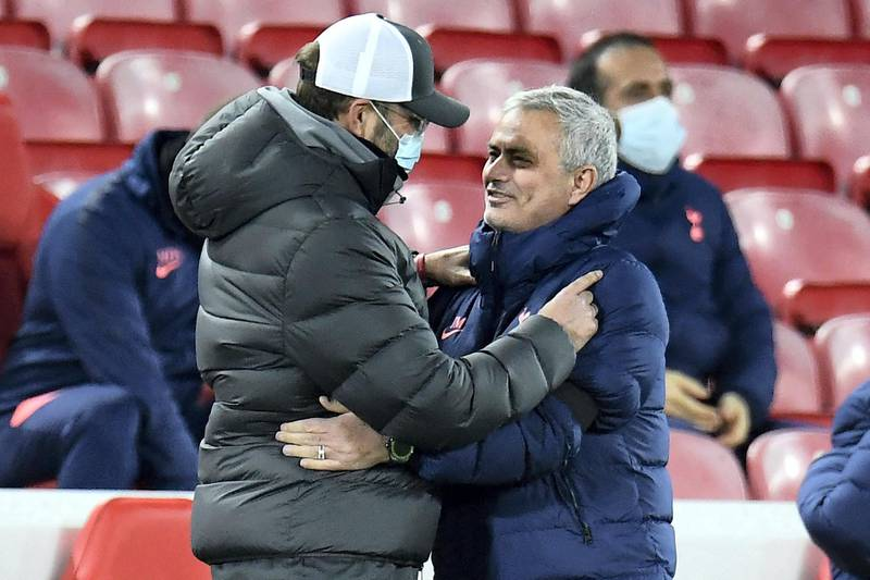 Liverpool's German manager Jurgen Klopp (L) wearing a face mask or covering due to the COVID-19 pandemic, greet Tottenham Hotspur's Portuguese head coach Jose Mourinho ahead of the English Premier League football match between Liverpool and Tottenham Hotspur at Anfield in Liverpool, north west England on December 16, 2020. (Photo by PETER POWELL / POOL / AFP) / RESTRICTED TO EDITORIAL USE. No use with unauthorized audio, video, data, fixture lists, club/league logos or 'live' services. Online in-match use limited to 120 images. An additional 40 images may be used in extra time. No video emulation. Social media in-match use limited to 120 images. An additional 40 images may be used in extra time. No use in betting publications, games or single club/league/player publications. /
