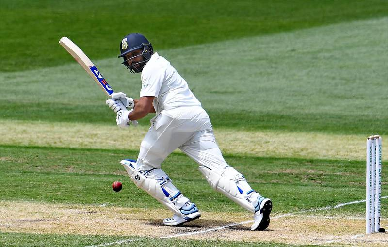 (FILES) In this file photo taken on December 27, 2018 India's batsman Rohit Sharma plays a shot during day two of the third cricket Test match between Australia and India in Melbourne. One-day big hitter Rohit Sharma will stake a claim to become India's first-choice opening Test batsman when they start a series against South Africa on October 2 looking for a record breaking win. Victory in the three-match series would see India break Australia's record of 10 straight series wins on home territory.  - -- IMAGE RESTRICTED TO EDITORIAL USE - STRICTLY NO COMMERCIAL USE --    / AFP / WILLIAM WEST / -- IMAGE RESTRICTED TO EDITORIAL USE - STRICTLY NO COMMERCIAL USE --