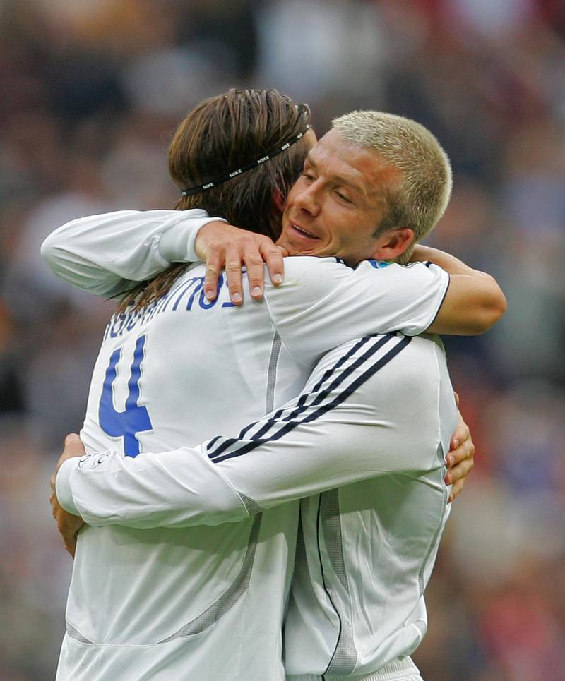 MADRID, SPAIN - MAY 26:  David Beckham (R) of Real Madrid celebrates with Sergio Ramos after Real scored their first goal during the Primera Liga match between Real Madrid and Deportivo La Coruna at the Santiago Bernabeu stadium on May 26, 2007 in Madrid, Spain.  (Photo by Denis Doyle/Getty Images)